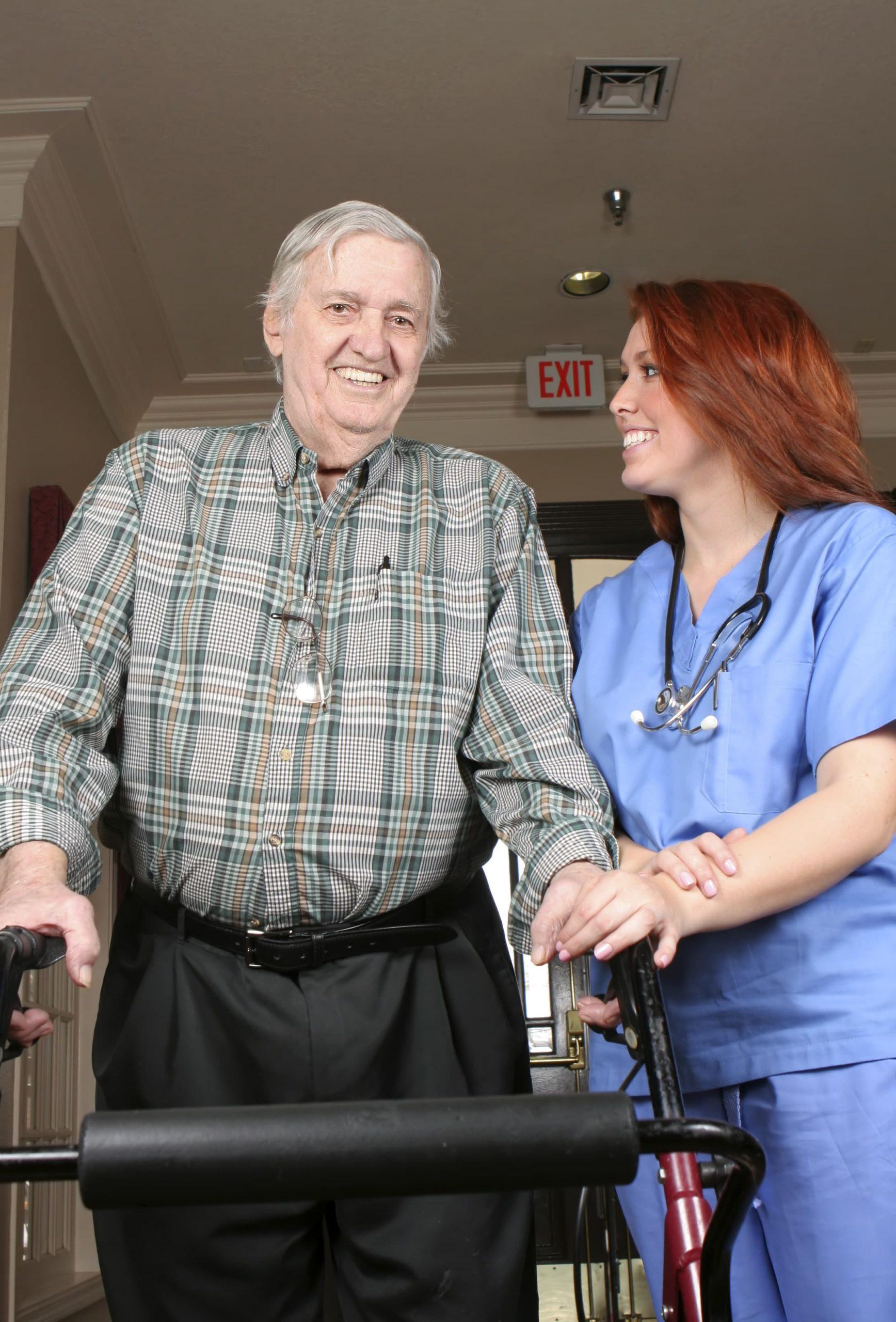 nurse with elderly man using walker cx scaled
